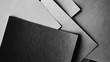 Leinwanddruck Bild - Minimal style papers in dark noir light room. Office supplies top view.
