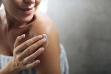 Woman Applying Moisturising Creme On Her Body
