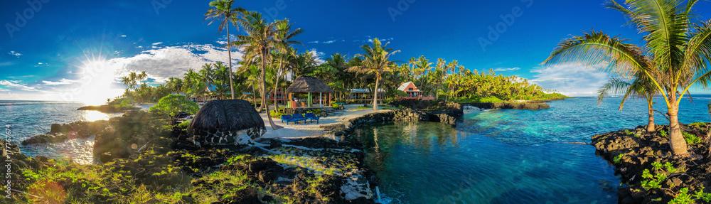 Fototapeta Panoramic holoidays location with coral reef and palm trees, Upolu, Samoa Islands.