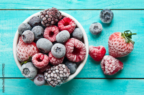 Obraz Frozen berries in a bowl closeup. Frozen berries. - fototapety do salonu