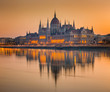 Budapes, Hungary - Beautiful orange sunrise at the Hungarian Parliament with reflection on the River Danube