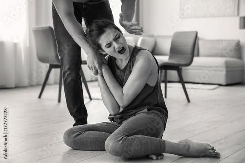 Fényképezés  Young woman subjecting to violence at home
