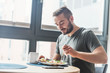 canvas print picture - Man eating a healthy breakfast.