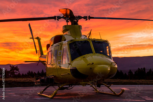 Tuinposter Helicopter Helicopter on a sunset