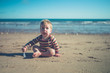 Little boy sitting on the beach