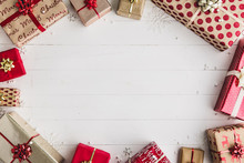 Wrapped Christmas Presents On A White Wooden Background