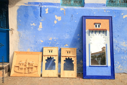 Fényképezés Wooden craftwork exhibited on a street in Chefchaouen for sale