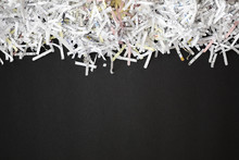 Shredded Documents Over Black ...