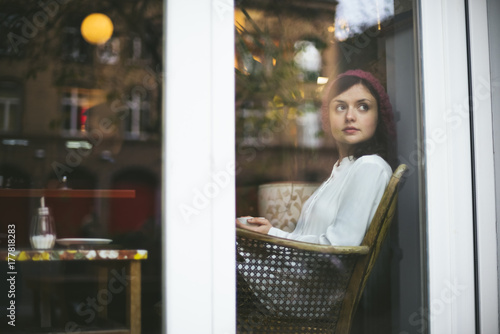 Young real Berliner girl sitting in a Hipster cafe