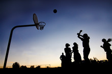 Street Basketball Players In Silhouette