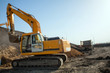 construction machinery at the construction site of the road in the quarry is gaining ground and pouring sand