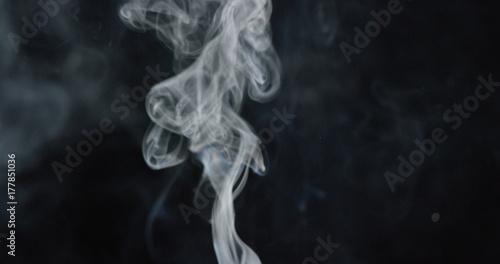 Fotobehang Rook Tower of smoke billows over dark background