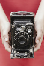 Woman Holding An Old Camera