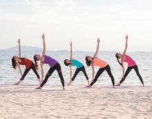 Yoga Class At Sea Beach In Eve...