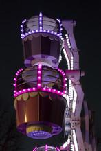Small Children's Ferris Wheel Illuminated Against A Night Sky