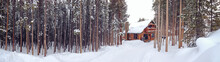 Panorama Of A Ski Cabin In A Mountain Forest Setting Surrounded By Deep Snow And Pine Trees