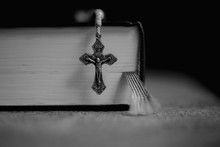Rosary And Bible On Table