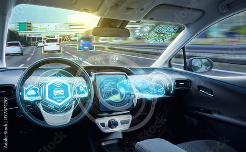 Fotografie, Obraz  Empty cockpit of autonomous car, HUD(Head Up Display) and digital speedometer