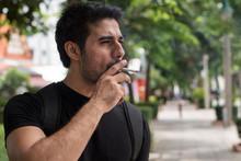 Asian Man Smoker Smoking Cigar...