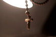 The wooden rosary in the light