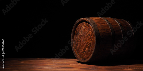 Stampa su Tela Rustic wooden barrel on a night background