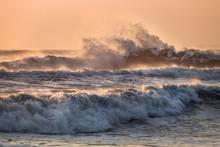 Sea Waves Crashing On A Rocky Pier, Italy, Tuscany