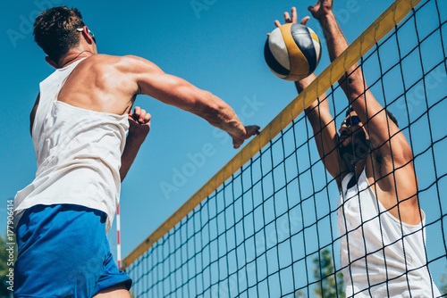 Beach volleyball detail - Males on the net