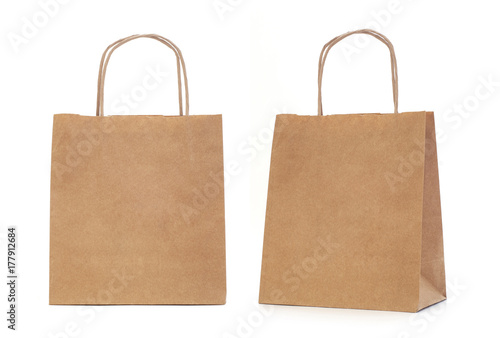 Photo Recycled paper shopping bag on white background.