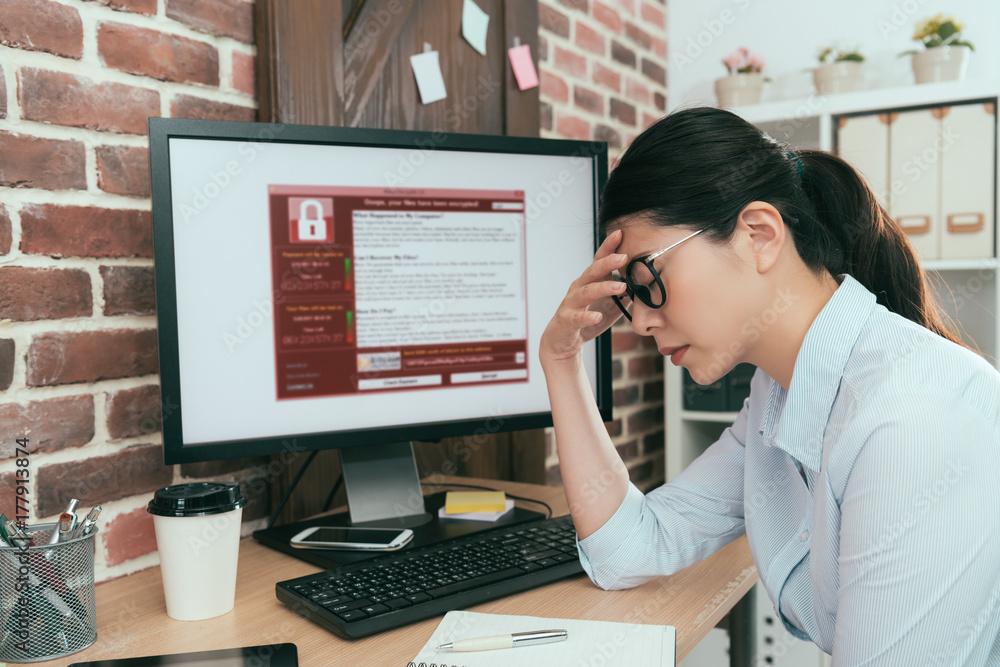 Fototapeta woman finding computer getting virus attack