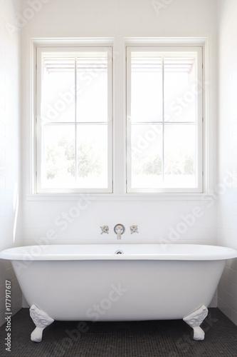 . Clawfoot bathtub in bathroom of modern design farmhouse   Buy this