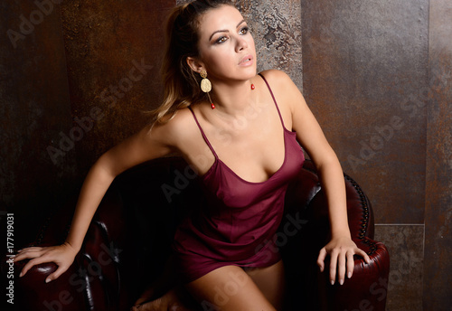 Fototapeta beautiful sexy woman in purple lingerie relaxing in white room