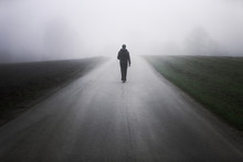 Man Walking Alone On Rural Mis...