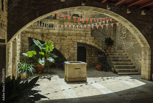 medieval courtyard of the ancient quarter of the city of Gerona, Spain.