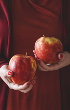 A Woman Holding A Red Apples  ...