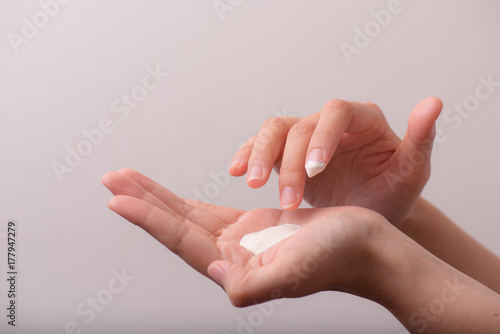 Fotografie, Obraz  close up of women hands receiving sunblock cream lotion