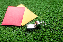 Red And Yellow Cards On Green ...