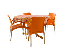 Four Orange Chairs And Table With Checkered Tablecloth Isolated On White Background