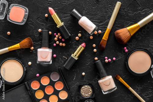 Beige and nude tones cosmetics for natural makeup on black background top view Fototapet