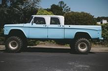 Vintage Blue Mud Truck Sits On A Rural Street
