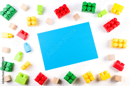 Colorful wooden cubes and plastic construction blocks with blue