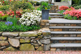 Fototapeta Kamienie - Beautiful Stone Wall And Steps, Colorful Garden, Curb Appeal