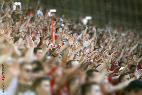 Obraz na plátne Football fans clapping on the podium of the stadium