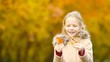 Little kid outdoors have fun at beautiful warm day with yellow leaf in fall