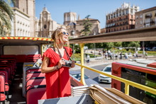 Young Happy Woman Tourist In R...