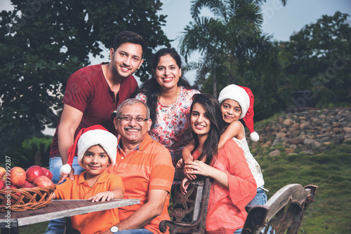 Indian family celebrating christmas and posing for a group photo Canvas Print