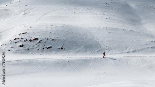 Foto op Plexiglas Alpinisme Healthy lifestyle, distant hiker walking forward on snowy mountain