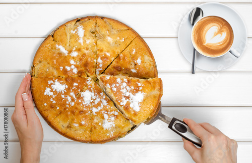 Spoed Foto op Canvas Pizzeria Cake pie with apples cup of coffee