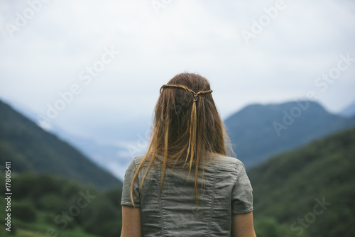 Young and free woman exploring nature