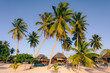 Beach huts - bungalows on a resort on beach of exotic tropical island