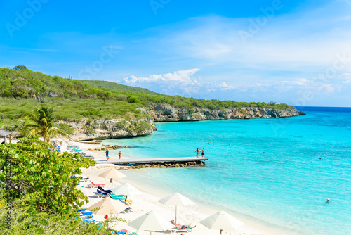 Photo  Porto Marie beach - white sand Beach with blue sky and crystal clear blue water